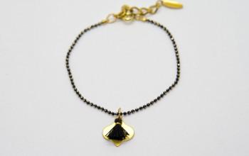 Schwarz goldenes Armband mit Quaste