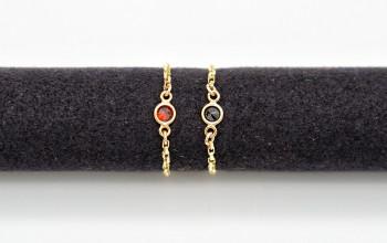 Goldener Ketten-Ring mit kleinem Schmuckstein