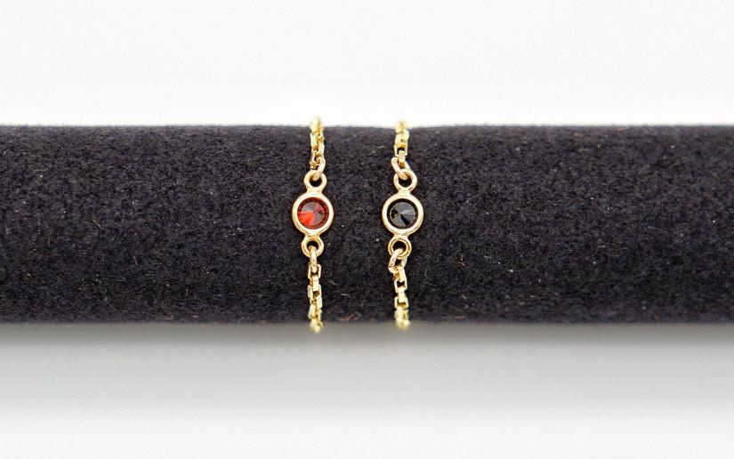 Goldener Ketten-Ring mit kleinem Granat